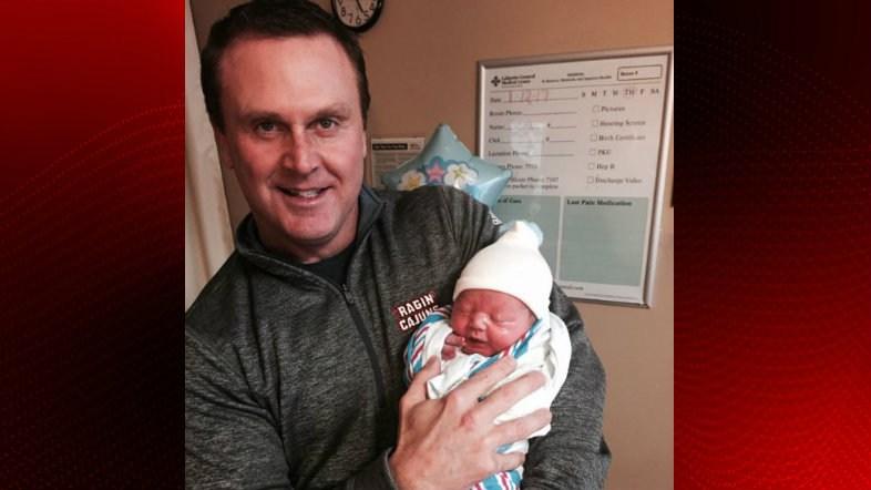 Coach Mark Hudspeth and baby Rocky Nash