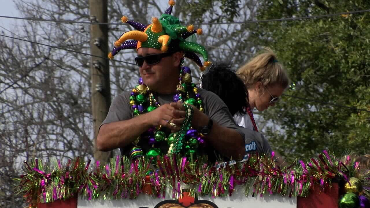 Thousands of residents lined the streets of Scott for their 21st annual Mardi Gras Parade.