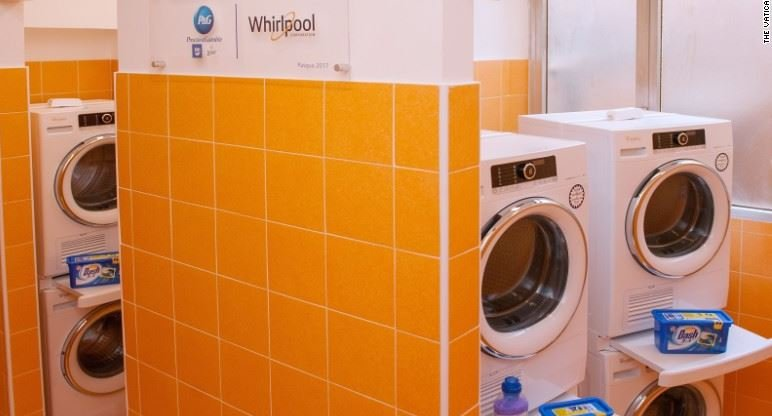 Pope opens free laundromat for Rome's poor