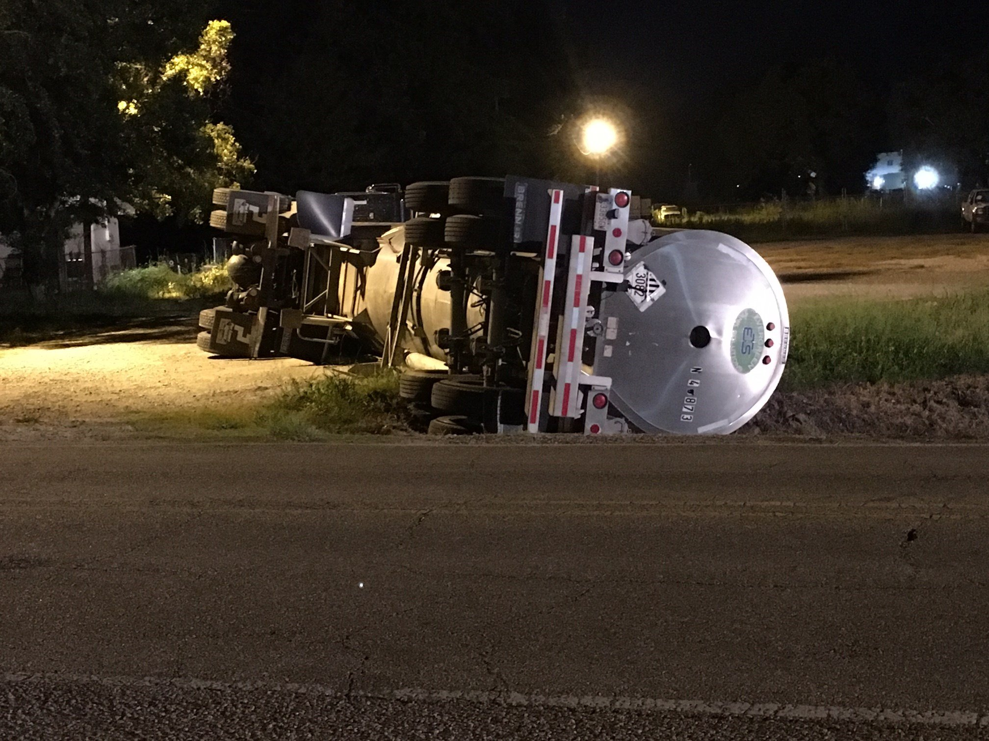 Tanker carrying haz-mat materials crashes in ditch