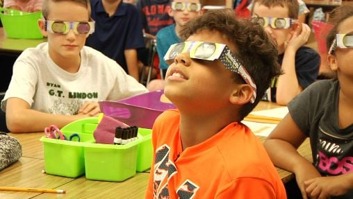 Third graders at Green T. Lindon Elementary School prepare for the solar eclipse.
