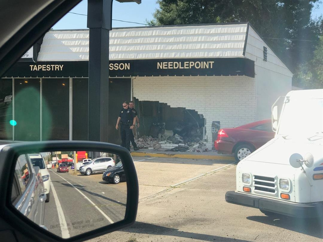 SUV plows into Johnston Street business