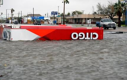 The roof of a gas station sits in flood waters in the wake of Hurricane Harvey, Saturday, Aug. 26, 2017, in Aransas Pass, Texas. AP Photo/Eric Gay