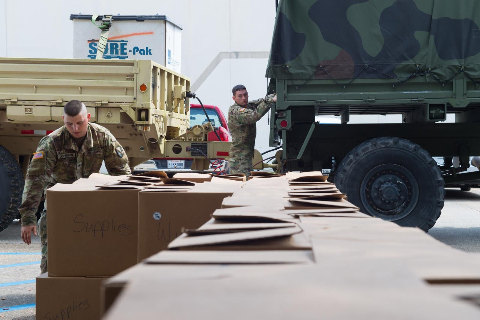 Louisiana National Guardsmen, Spc. Billy Johnson and Pfc. Nicholas Hebert with the 922nd Horizontal Engineer Company, load medical supplies donated by the Trach Mommas in Baton Rouge, Sept. 27, 2017. The supplies are destined for Puerto Rico to provide cr