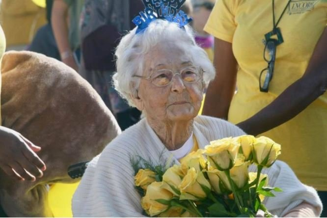 Photo Caption: Cecelia Young receives yellow roses (her favorite color) from Crowley businesses as she celebrates 106.