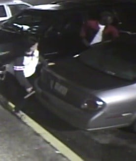 Suspect with gun at scene of the robbery