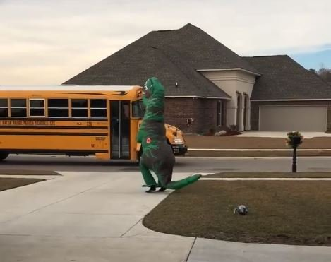 Dinosaur dad greets daughter at the bus stop / Courtesy: Tad Megan Parnell