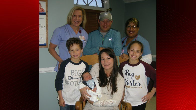 Baby Holden Seth Ortego, parents: Annie and Joshua Ortego, siblings: Karleigh and Wesley, health system staff Pam Major, Clinical Director of Women Services and Tristen Thomas, RN.