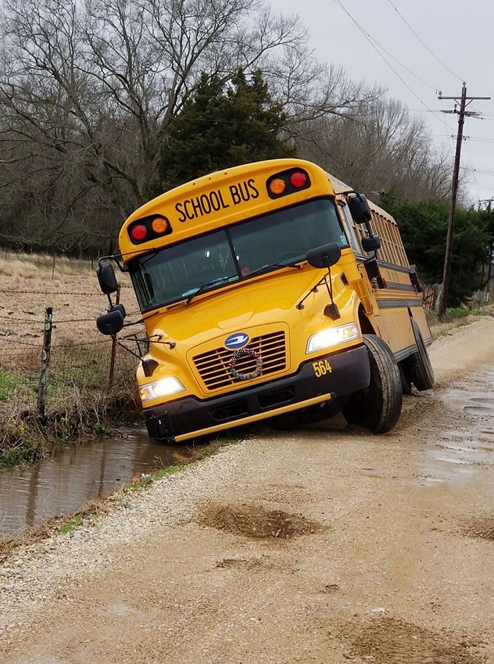 A St. Landry Parish school bus ended up in a ditch after the driver served to avoid a pothole on Chris Road / Courtesy: Amber Hammond