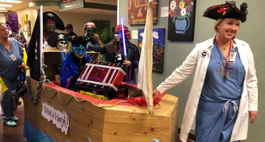 Janice Ryan, RN, Surgery Department Director, leads her Surgery team and their specially designed Pirate Ship float in the sixth annual Mardi Gras parade Friday, Feb. 9 at Women's & Children's Hospital.
