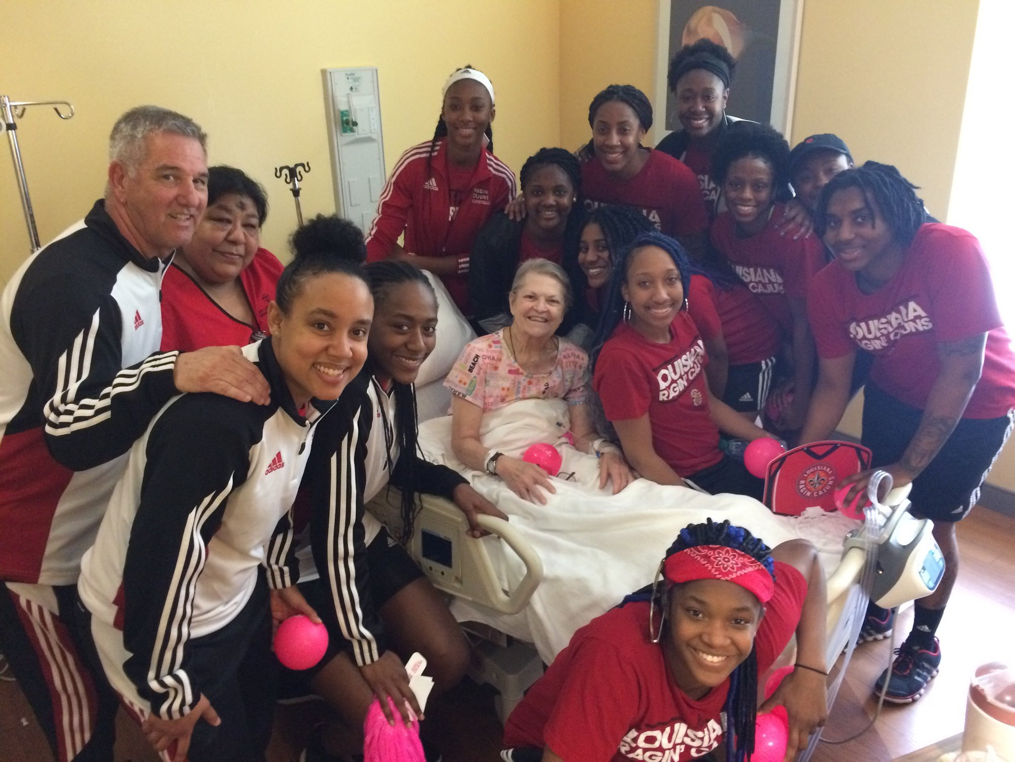 Janet Guidry is an oncology patient at our Lady of Lourdes on the fifth floor. She received a very welcome surprise today by a group of very bright and cheery young UL athletes.
