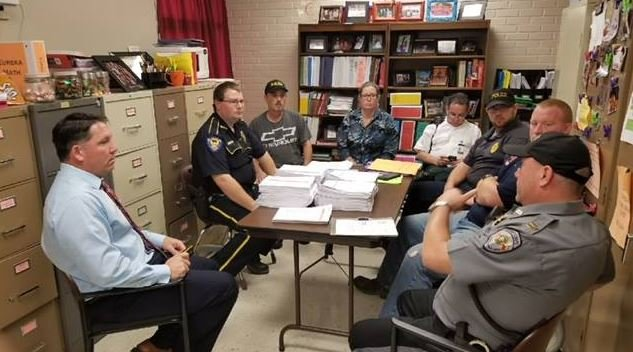 Pine Prairie High School officials meeting with law enforcement / Pine Prairie High School Facebook