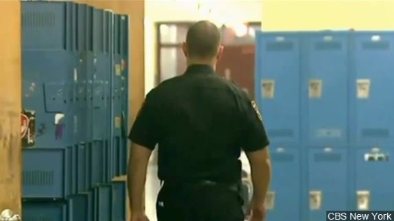 File photo of officer sweeping school for weapons.