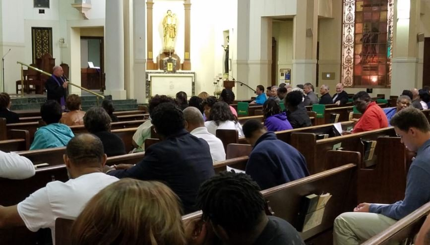 New Iberia residents pray for an end to violence at St. Peter's Catholic Church / KATC