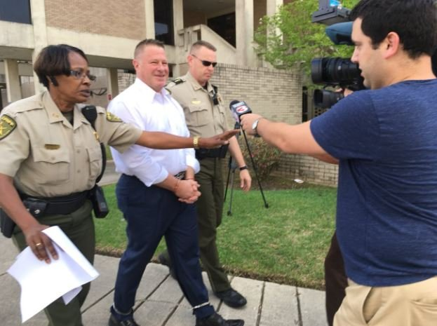 """Lafayette City Marshal Brian Pope is escorted to the parish jail on Feb. 28, 2018, after a judge finds he's done """"nothing"""" to satisfy the terms of his probation. Lanie Lee Cook/KATC TV3"""