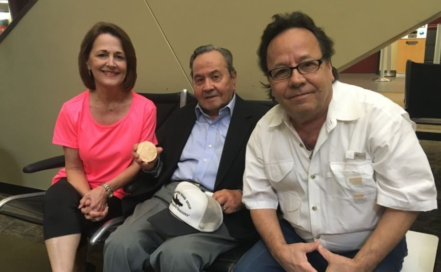 Hewitt Gomez, center, and his son Gary and daughter Cheryl at the Lafayette Airport
