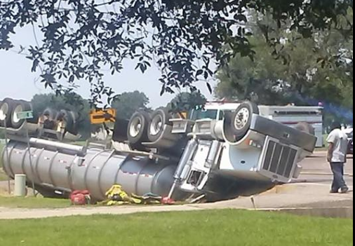 Truck Carrying Vinegar flips on Coteau Road. / Christie Frederick
