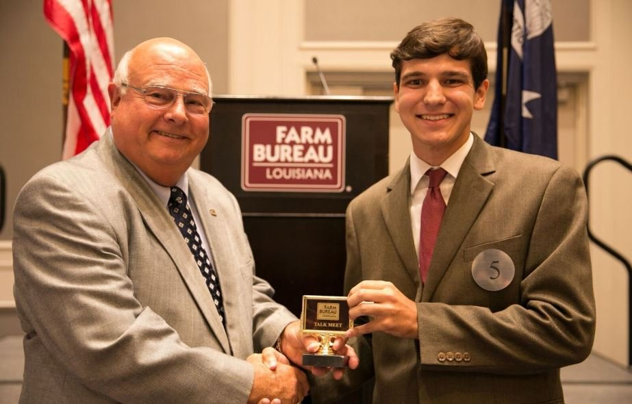 Bret Lee of Vermilion Parish receives his award for participating in the 2018 Talk Meet from Louisiana Farm Bureau President Ronnie Anderson.