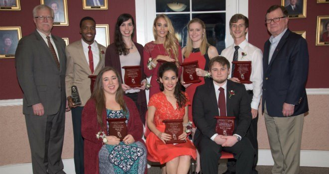 Seated from left, are: Margot Fry, Annie Briley, Kevin Thomas Malone. Standing, from left, are: Dr. Jim Henderson, Leondre' Queen, Brittany DiNunzio, Anastasiya Gromova, Emily Gauthier, Gage Seaux, and Dr. Joseph Savoie.