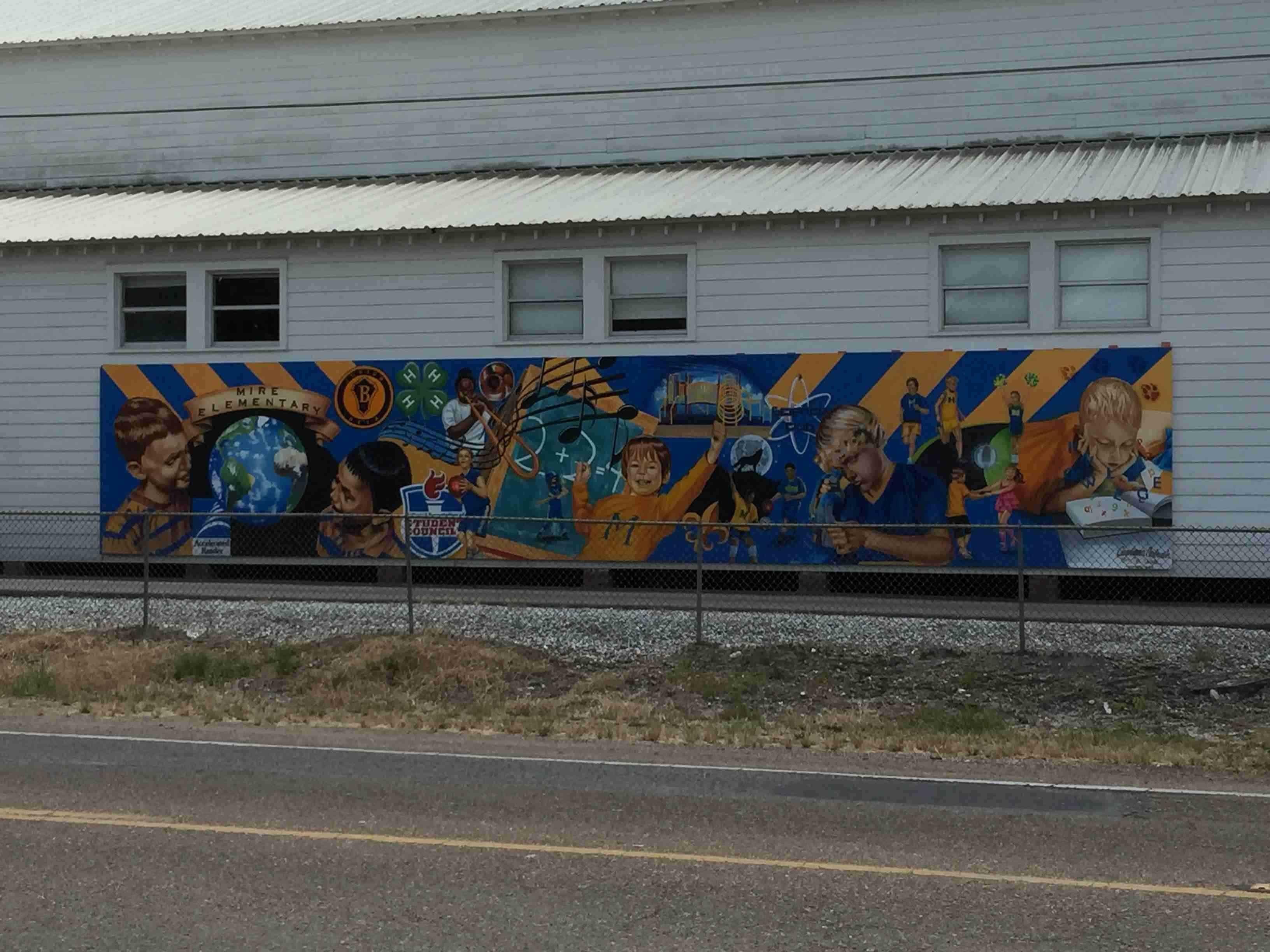 Lafayette artist paints mural at mire elementary school for Elementary school mural